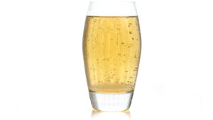 Fizzy, translucent amber coloured Bakerstreet and Ginger in a glass