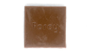 Carmel coloured chocolate square embossed with the Foray logo